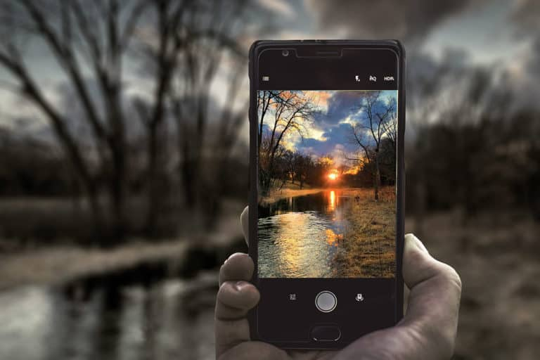 iPhone with sunset phopto